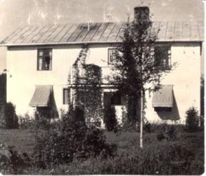 Vårt hus på 1950-talet, vitt med rödbruna fönster.
